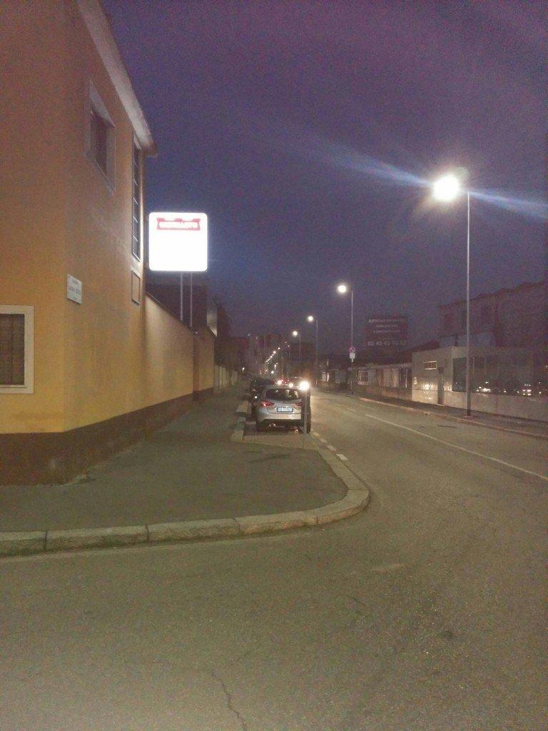 ...and down the sidewalk of the Via Privata Gaetano Sbodio.