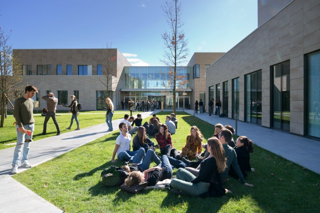 Humanitas University students socializing on the grass